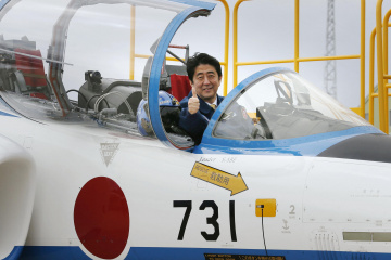 Japan's Prime Minister Shinzo Abe poses inside a cockpit of T-4 training jet plane in Higashimatsushima
